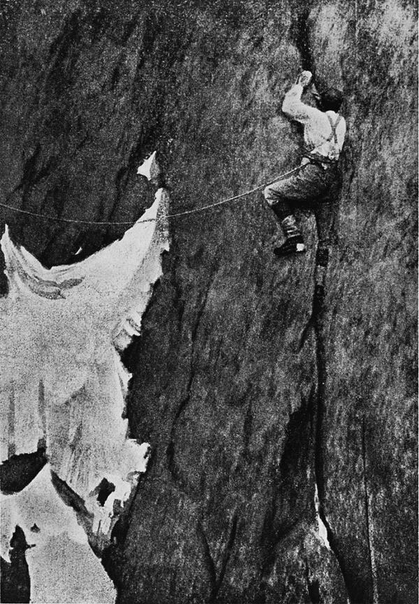 """Lily Bristow, """"La fessura Mummery"""", 1893. Con l'incastro della gamba destra, Mummery sta superando la sua celebre fessura e Lily Bristow scatta dal Portail  du Charmoz questa immagine, esemplare tanto per la storia che racconta, quanto per l'esatta identificazione del passaggio (A.F. Mummery, """"Mes escalades dans les Alpes et le Caucase"""", L. Laveur, Paris 1903)"""
